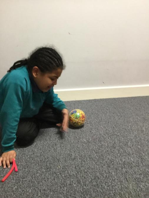 Expoing rolling a ball