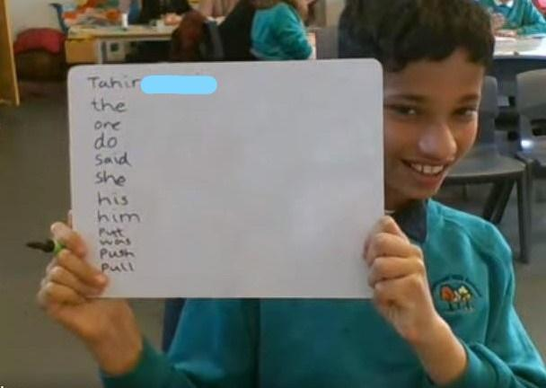 Tahir - writing words in a list down the board.