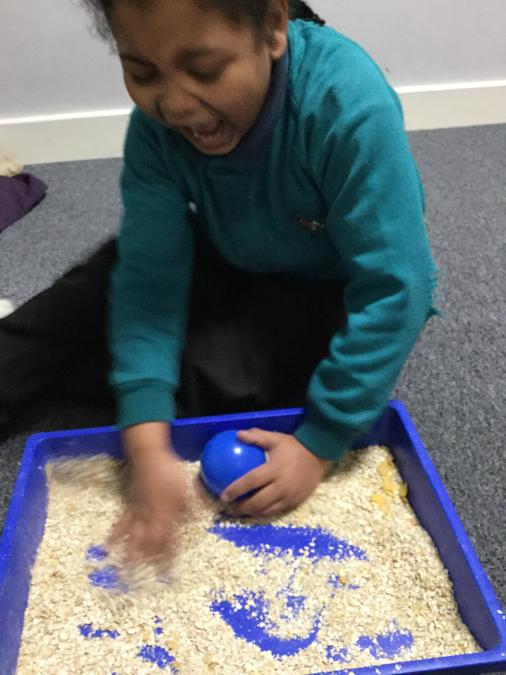 Rolling a ball in oats