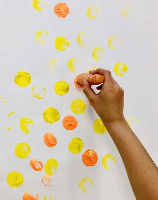 Pointillism (dot) painting with a carrot.
