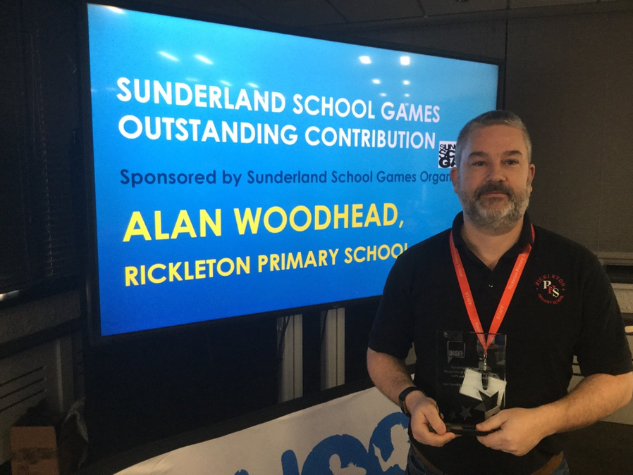 Mr. Woodhead collects his award in 2020.