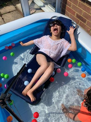 Thaskeen having fun in the pool