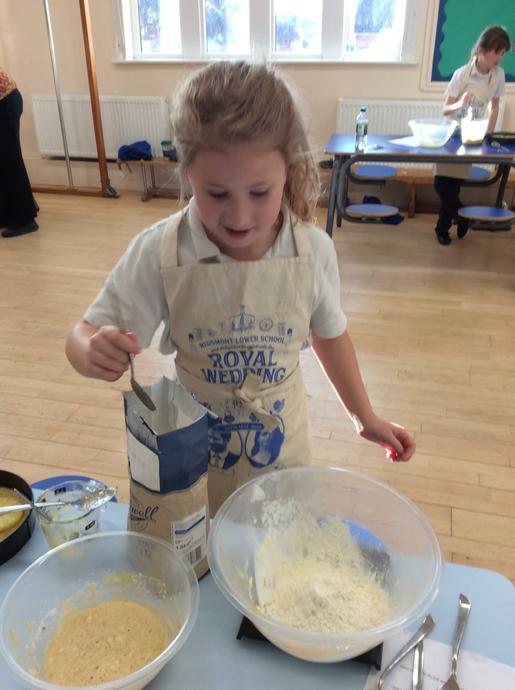 Imogen is weighing flour.