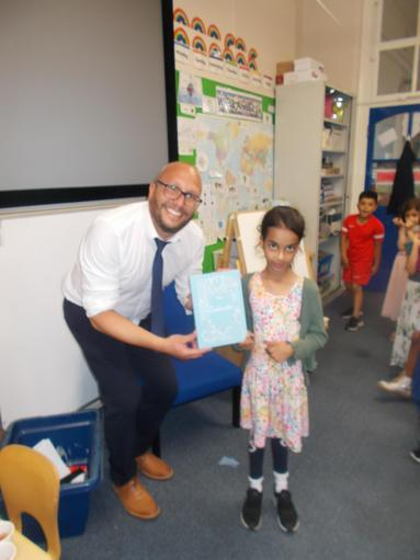 Adan with Mr Davis and the beautiful,material  book she chose.