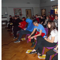 The students watching the pantomime on the big screen.