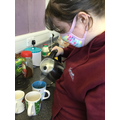One of our students making tea and coffee.