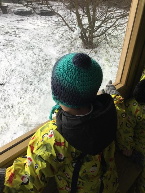 Looking out at the snow from the outdoors classroom window.