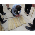 Measuring the wood.