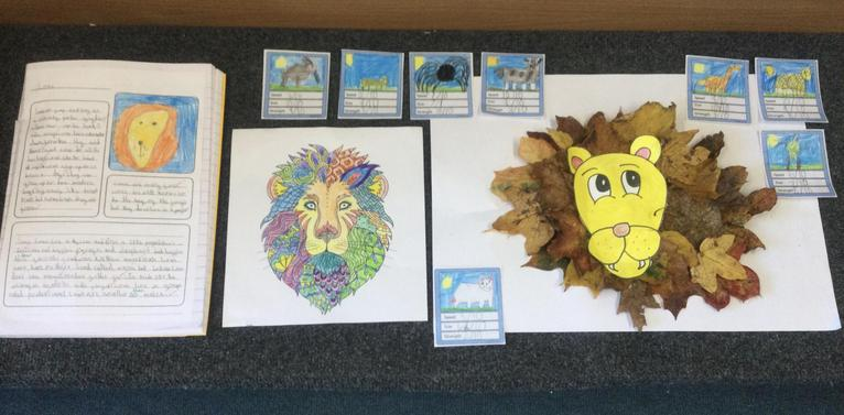 Lion fact files, colouring, collage and top trump cards!