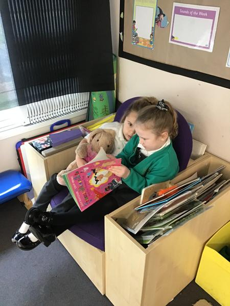 Sharing a story. We are a book loving school!