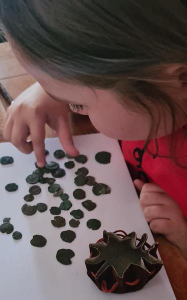 Millie examining some Roman coins