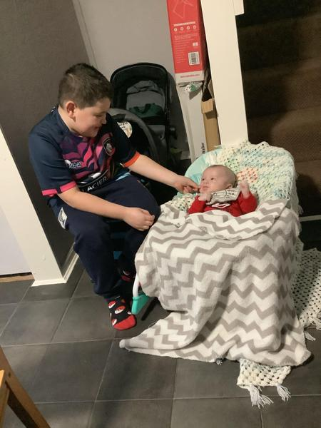 Jaxon looking after his little brother