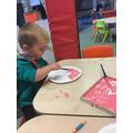 Holding our paintbrushes carefully 😀