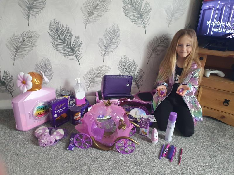 Chloe with her collection of purple objects.
