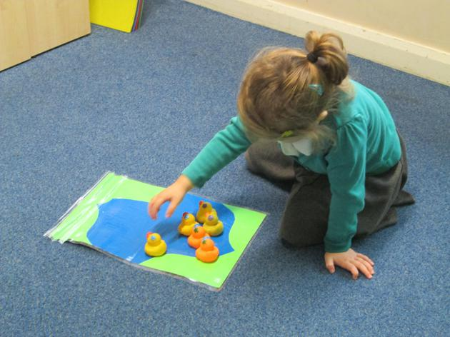 Continuing a numeracy activity independently.