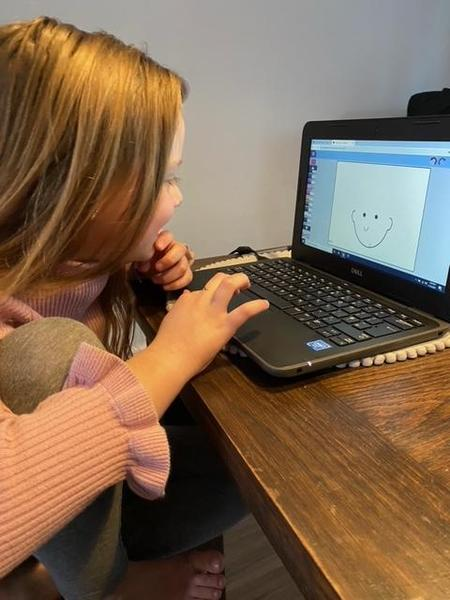 Chiara enjoying her new latiptop- busy on Purplemash