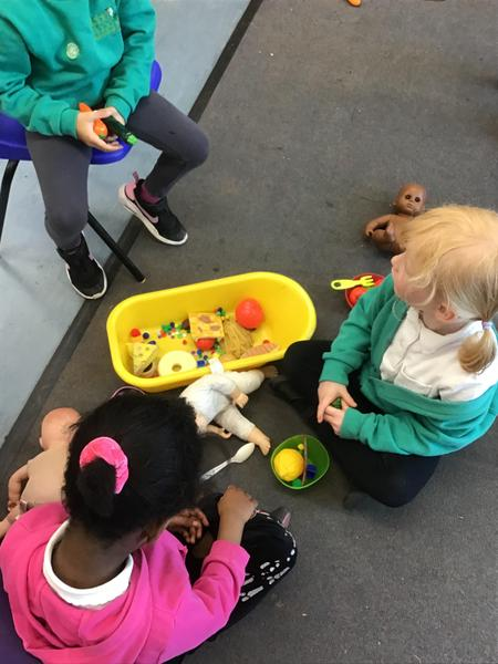 Playing together and sharing our toys.