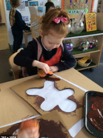Make a stencil from cardbard and add paint to create a gingerbread man.