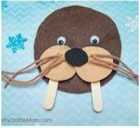 brown card/ material, 2 x lollypops sticks, googly eyes