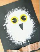 black paper, white paint, yellow and black card