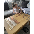 J has been using real coins to help her maths