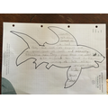 F has created a shape poem about sharks