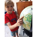 Using a globe to find Europe