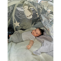 She loves sensory play with a survival blanket.