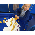 Using play dough to make bananas.