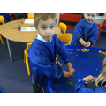 Squeezing oranges when we learnt the 'o' sound.