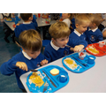Trying the school dinners.
