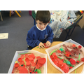 Making Poppies with red and green items.