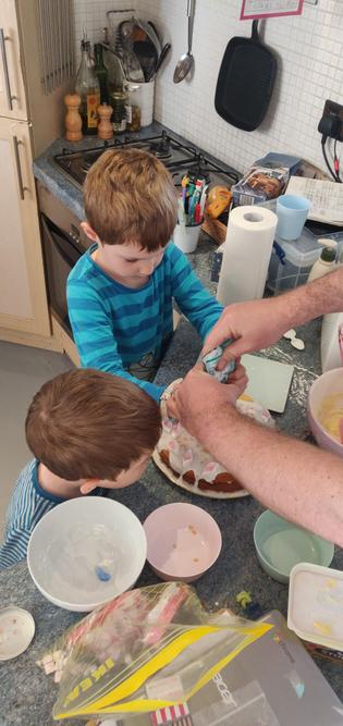 Here is Albie helping to decorate the cake