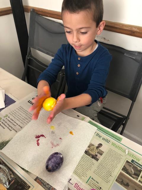 Georgi colouring traditional Bulgarian Easter eggs