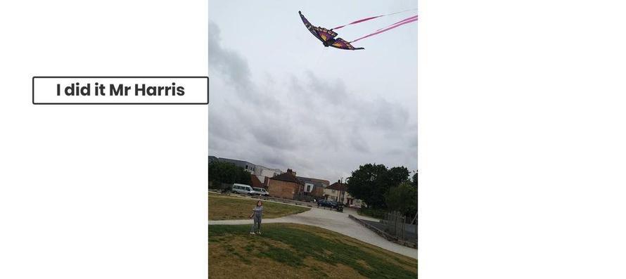 Eliza flying a huge butterfly kite.