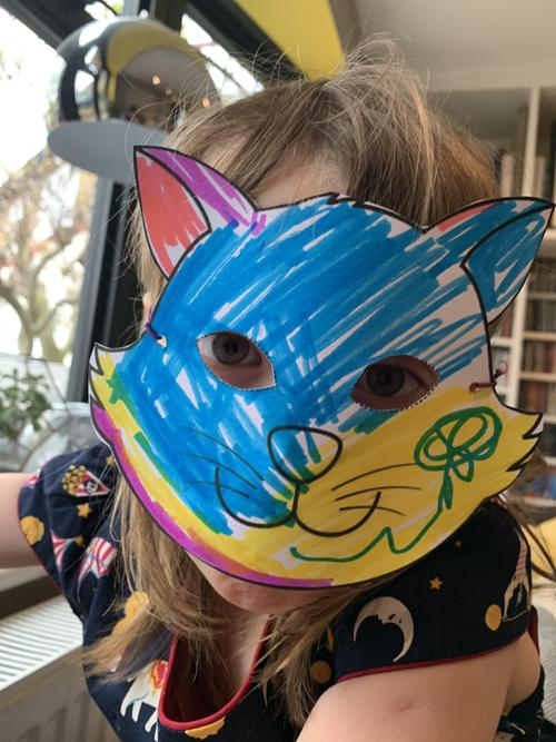 A wonderful mask! Who do you think is hiding?