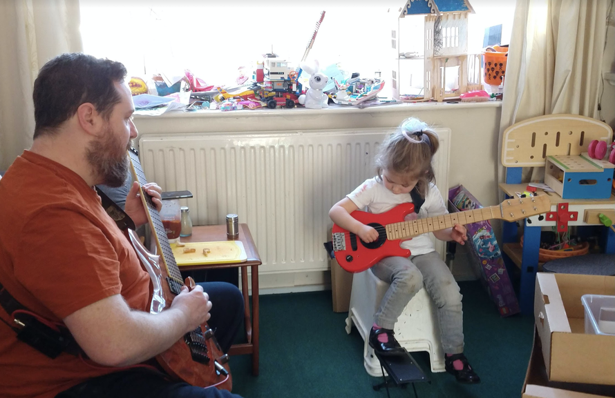 Beth has been playing the guitar with her dad.