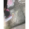 Practising E outside on the ground with chalk!