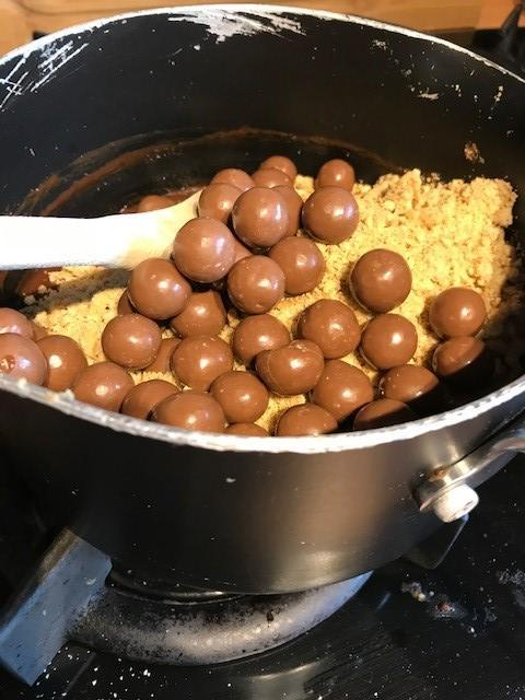 Add the crushed digestives and maltesers