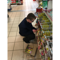 Luke stacking the sweets in Supervalu