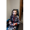 Regan on playstation in her favourite Xmas PJ's.