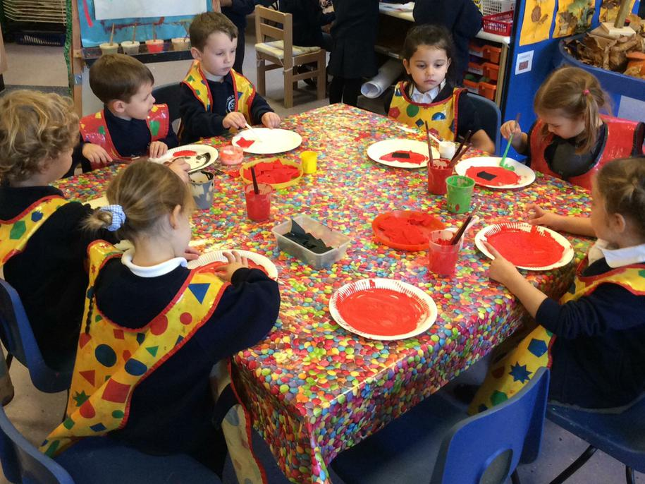 Today we made Remembrance Day poppies.
