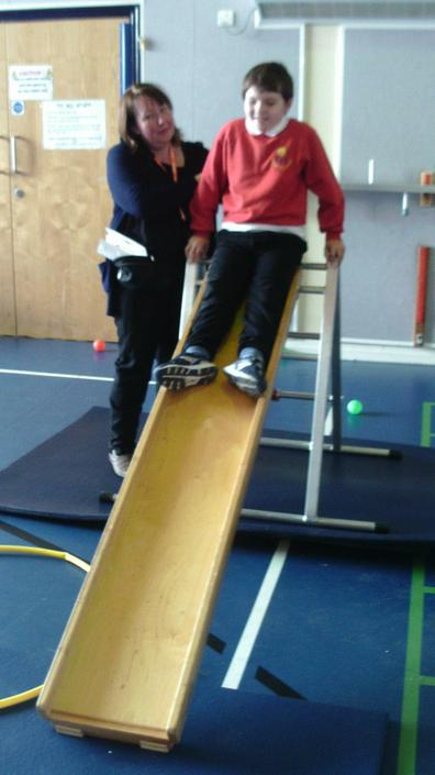 Jack using the slide in P.E