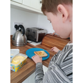 Life skills, our pupil independently making toast.