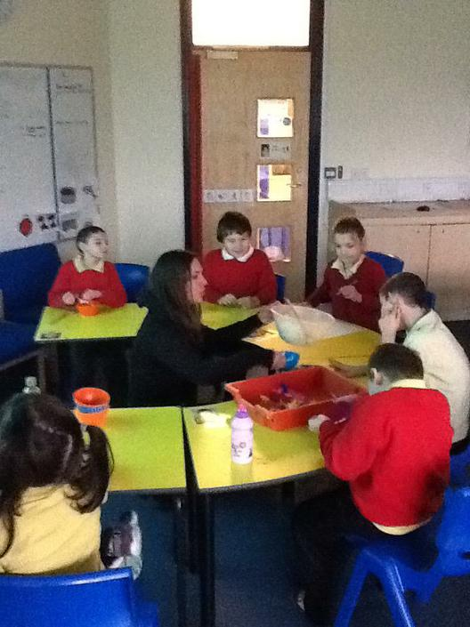 The whole class enjoying a cookery lesson