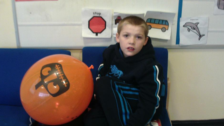 Ben playing with sensory balloons
