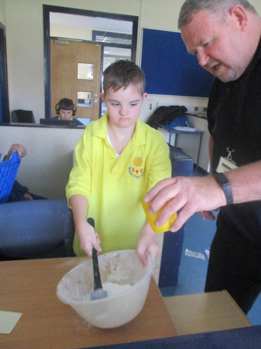 Mixing the drops of milk for our cake.
