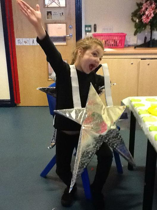 Evie dressed as a Star for the Nativity