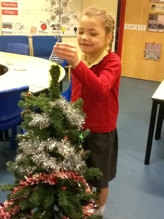 Evie decorating our Christmas tree
