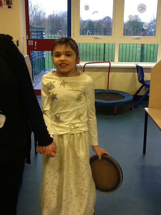Maya dressed as a Star for the Nativity